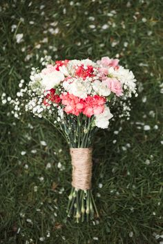 Homemade DIY pink and white carnation and gypsophila bouquet, wrapped in twine. www.catlaneweddings.com
