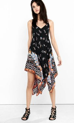 Heed the call of music festival fashion. Delicate sprays of pink, orange and blue flowers are grounded on a black background on the top of this sundress, while a bold, placed print turns up the volume on its flirty, handkerchief hem.