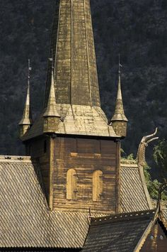 "Stave church, Lom, Oppland, East Norway: A stave church is a medieval wooden church with a post and beam construction; the load-bearing posts (""stafr"" in Old Norse) have lent their name to the building technique."