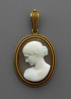Gold pendant set with a sardonyx cameo of a female profile portrait bust and with a border of corded wirework in the 'archaeological style' with twisted wire circles on the pendant loop and open on the back with a monogram in gold wire. Rome 1860.