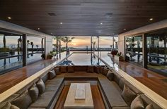 Atlantic Beach Modern by Content Architecture THE BRILLIANT ASPECT OF THIS ROOM IS THAT SITTING ON A PLANE LOWER THAN THE FLOOR GIVES A MORE EXPANSIVE VIEW OF THE EXTERIOR AND SKY BECAUSE YOU ARE OVERCOMING THE RESTRICTION OF CEILING HEIGHT RELATIVE TO THAT VIEW!