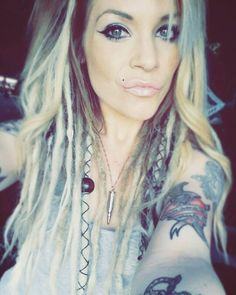 "My platinum blonde ombre ""half dreads"" with some leather wraps and beads after about a month"