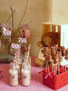 Chocolate covered gummi bears on toothpicks.