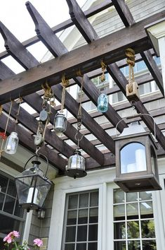 Patio decor idea inspired by Pottery Barn .. rope and an assortment of lanterns and pulleys.