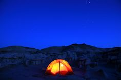 Campsite at night with star trails in the Bisti Badlands Wilderness area, New Mexico