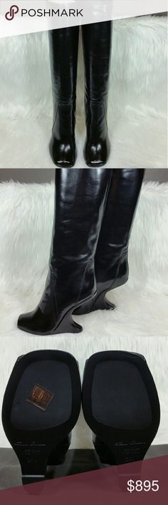 """RICK OWENS Cyclops Cantilevered open toe boots Save $700 (44%)  RICK OWENS SS16 CYCLOPS OFF-THE-RUNWAY CYCLOPS CANTILEVERED BOOTS IN BLACK LEATHER HAVE A HIGH CURVED WEDGE, STITCHING DETAILS AND AN UNDER THE KNEE LENGTH.  UPPER: 100% GOAT LEATHER. LINING: 100% CALF LEATHER. INSOLE: 100% CALF LEATHER. INTERSOLE: 100% CALF LEATHER. OUTSOLE: 100% RUBBER.  HEELS 4"""". MADE IN ITALY.  Brand new. Never worn. Comes with box and dust bag. Can provide more pictures and info upon request. Make an offer…"""