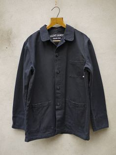 Saint James Artist Jacket in hardwearing navy blue cotton drill. Traditional canvas jackets and workwear made in France by St James since Saint James Clothing, Denim Button Up, Button Up Shirts, Ivy Style, Canvas Jacket, Mont Saint Michel, Work Jackets, Casual Chic, Nike Jacket