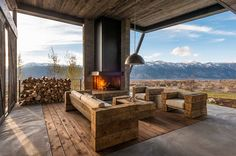 Gorgeous fireplace for the open entry room with mountain views