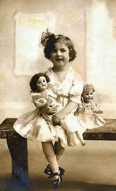 Girl with dolls.