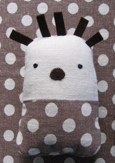 Cute little softie with a back pocket for cash, gift card, voucher, etc.