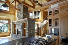 Kitchen, dining, living rooms - great open space, amazing light and view. I love the stone and high ceiling.