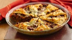 Italian Crescent Casserole - ground beef, basil garlic tomato sauce, crescent rolls, shredded cheese, dried basil