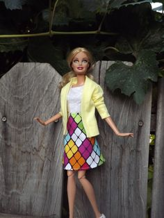 Ok--i totally love how lifelike this Barbie looks! It's like a senior portrait.   Multicolored Flared Barbie Skirt by PinkPolkaDotPlace on Etsy, $4.50