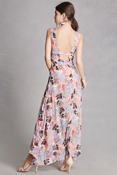 A crepe woven maxi dress featuring an abstract floral print, sleeveless cut, deep V-neckline, front and back geo cutouts, a layered side slit skirt, and a concealed side zipper closure. This is an independent brand and not a Forever 21 branded item.
