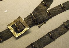 Tablet woven belt with brass buckles and bars, medieval. Nationalmuseet, DK