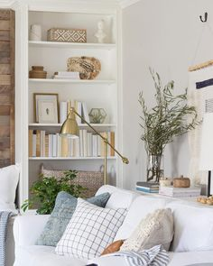 Bookcase goals That metal lamp and those textured throw pillows elevate this simply styled living room. (: @shadesofblueinteriors) #thecottagejournal #cottagestyle #cottage #repost