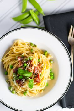 Pea & Bacon Pasta - Pasta topped with a creamy sauce, bacon and peas