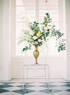 An arrangement of white peonies, creamy yellow garden roses, white campanulas, and elaeagnus. Landon Jacob Photography / Styling by Jessica Rourke