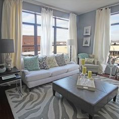 City Loft living room - Love!  One day when I don't have animals I will have a white sofa.