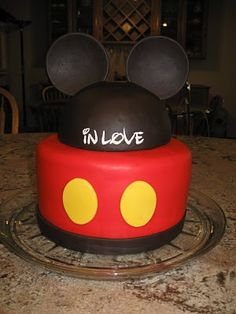 "MIckey cake~ My favorite...bottom band needs to be yellow and the 2 buttons need to be white! Could write ""John"" on the hat. Need fondant since red icing would be very hard to get."