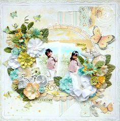 #scrapbook page.  Flowers cover the page with various cut outs from the paper line