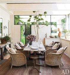 DeGeneres and De Rossi added a screened porch, where a 19th-century trestle table is paired with wicker armchairs.      1    2    3    4    5    6    7