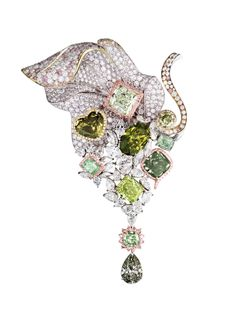LEVIEV Fancy Green, Pink and White Diamond Brooch boasting 10 multi-shaped Green Diamonds totaling 65.25 carats, handcrafted in platinum and 18 karat pink gold.