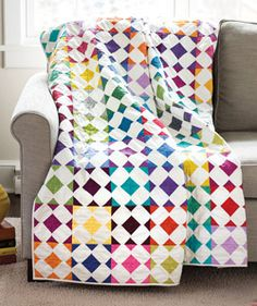 """Designer Thomas Knauer loves adding bits of color to the corners of squares, and then creating new shapes when the blocks are sewn together. This fat quarter friendly quilt features each color of your stash perfectly in 6"""" quilt blocks."""