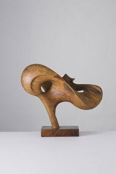 Mario Del Fabbro wood sculpture. His mid century book series on building modern furniture is fantastic.