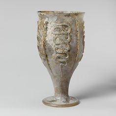 Glass beaker with snake-thread decoration. Late Imperial, century A.D, Rhineland, Glass, blown and trailed. Antique Glassware, Antique Bottles, Cut Glass, Glass Art, Art Ancien, Roman Art, Medieval Art, Ancient Artifacts, Ancient Romans