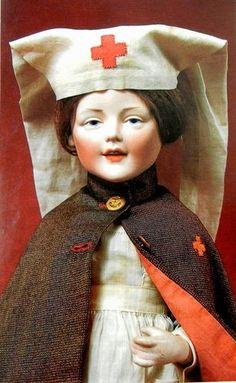 German bisque head doll dressed as a Red Cross nurse by Fritz Bierschenk.