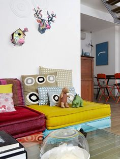 colorful stacked floor cushions and pillows