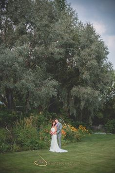 Bride and groom portrait under tree | Shalene is an Edmonton based photographer who specializes in wedding photography. Her photos are simple and elegant with a vintage style feeling.