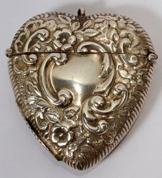 CONTINENTAL SILVER HEART-FORM MATCH SAFE,