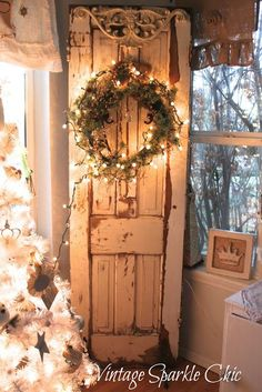 Shabby Chippy Vintage Door...with a lighted twiggy pine wreath.