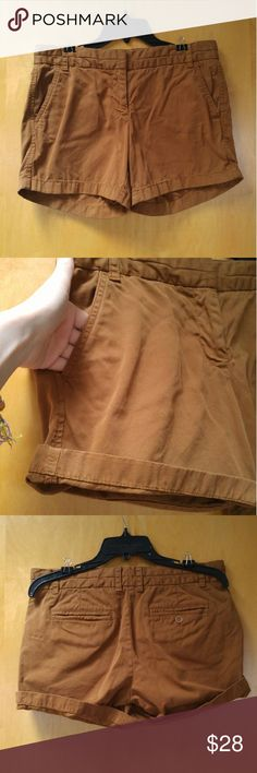 """J. Crew Brown Chino Shorts J. Crew brand chino shorts, size 6, in perfect condition! Color is a coppery brown. Features front and back pockets, belt loops, and zipper with tab button closure. Measurements are 16"""" waist, 13"""" length, and 5"""" inseam. Please ask any questions. No trades. Make a reasonable offer. Thanks! J. Crew Shorts Skorts"""