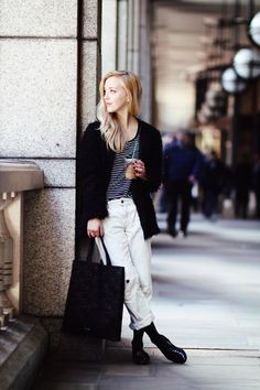 loose white pants, black oxfords with long black socks, loose breton top, textured jacket, large tote