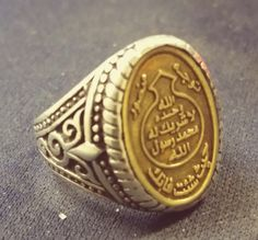 A silver arabic ring with the prophet muhammad's prophethood seal