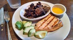 At Logan's Roadhouse - grilled salmon, sauteed mushrooms & I substituted avocado for the other side. Melted butter got drizzled over the salmon. :-) Yum!