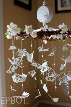 EPBOT: Sweet DIY Butterfly Mobile.  Look how she repurposed the old mobile ...cute!