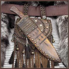 Mountain Man Bowie Knife and Sheath over a Scottish Sporran. this would be cool…                                                                                                                                                                                 More