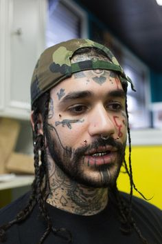 I like the forehead tattoo and the chin, but the rest are too much for me.