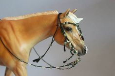 Miniature hand made Braided bridle owned by Anna Tackett and made by me.