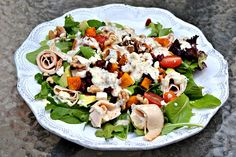 roasted butternut squash, deli chicken, avocado, walnuts, dried cranberries, tomatoes and feta with homemade whole grain honey mustard