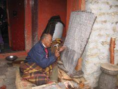 Buddhist monk creates sacred mani stone, Pangboche, Nepal