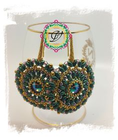 My earrings Iris. A rivoli decorated with superduo, round beads and drops. My pattern. Green, Gold and Lilac. 2015. Giuliana Verdelli Design.