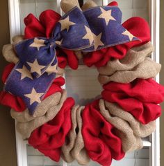Show your patriotism with this Burlap Wreath great for any room in your home or as a great display on your front or back door. Made of an wire frame, red burlap, burlap, and a blue burlap ribbon with stars. This wreath is 6 deep. (If youd like a larger or smaller wreath I can definitely accommodate you. Just send me a conversation.)  All of our wreaths do great outdoors but are better in a covered area and out of direct sunlight. Fading will occur on the fabric. I take pride in all of my…
