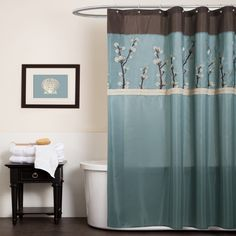 Elegant floral embroidery highlights this lovely shower curtain from Lush Decor. Constructed of faux silk, this shower curtain features a brown and blue color palette and is finished with pleated detailing.