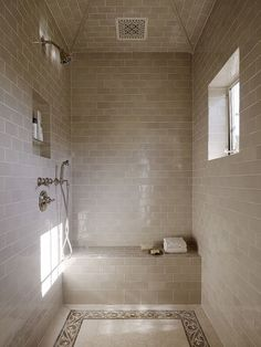 mediterranean bathroom by Alderson Construction: This shower has two things that can improve its air quality: a small window for fresh air and a fan. You can also take shorter showers to help reduce mold and mildew, since less moisture will need to be removed.