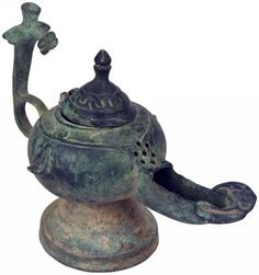 Sadigh Gallery's Byzantine Empire bronze oil Lamp, with a single spout, on a pedestal base. Genie Lamp, Occult Art, Byzantine Art, In Ancient Times, Ancient Artifacts, Oil Lamps, Antiquities, Ancient History, Archaeology